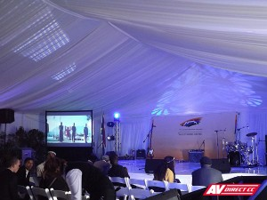stage and screens at the gugulethu name your hood event